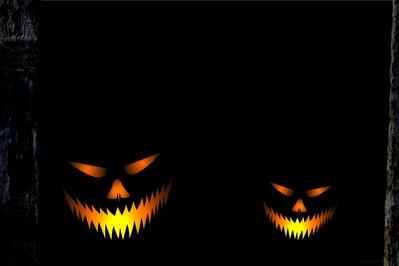 High def halloween wallpaper of jack O'lanterns in a dark barn.