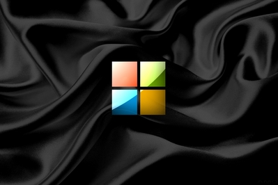 High def wallpaper of Microsoft's new 2012 logo on silky black fabric.
