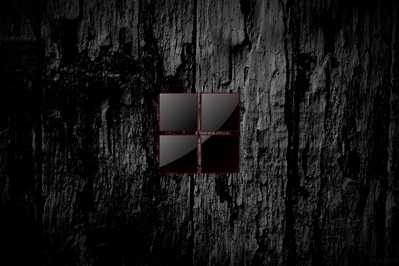 High def wallpaper of dark wood with Microsoft's new 2012 logo in blood red.