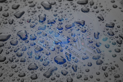 High def desktop background of blue PCB covered in water.
