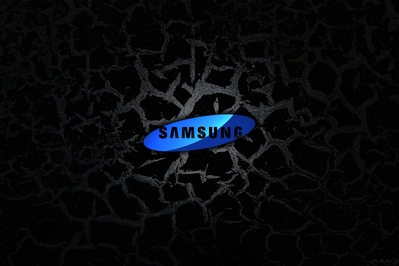 High def desktop background of Samsung logo on black cracked metal